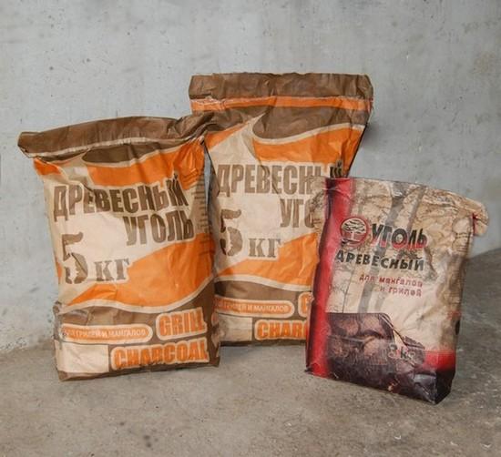 производство древесного уголя